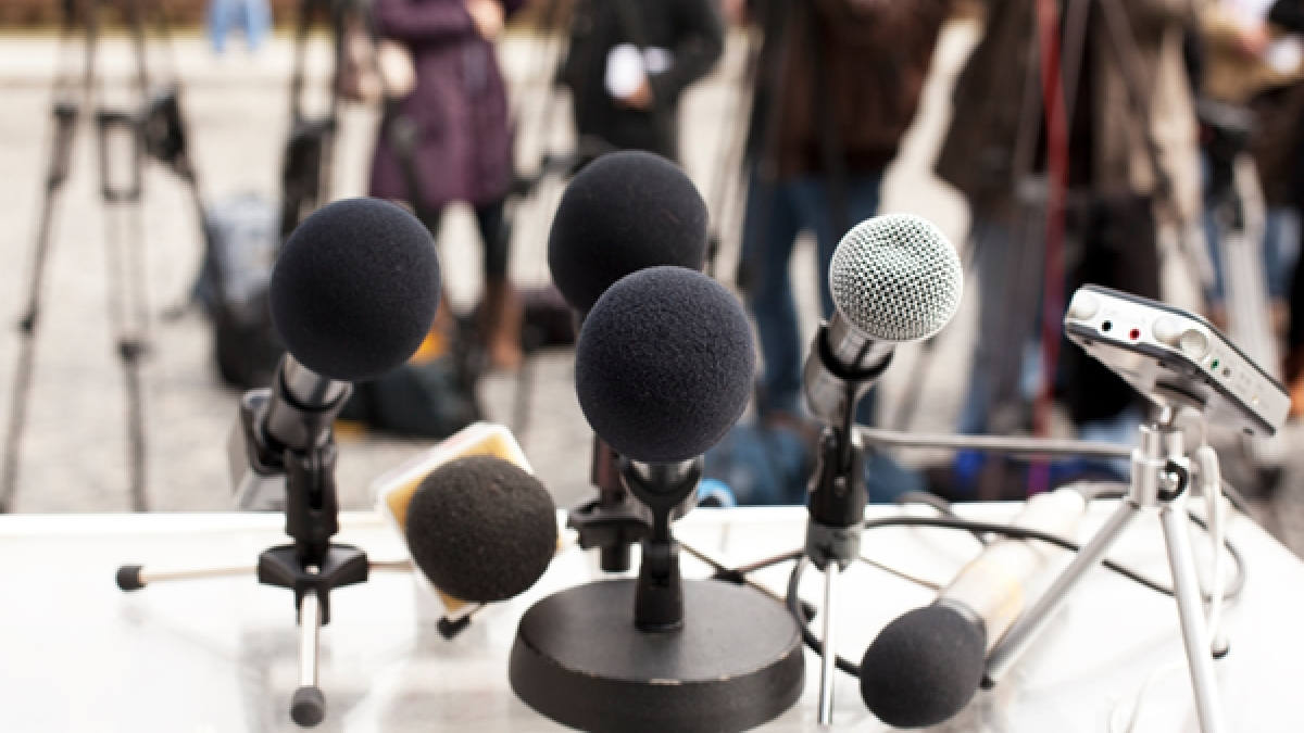 Microphones at a news conference